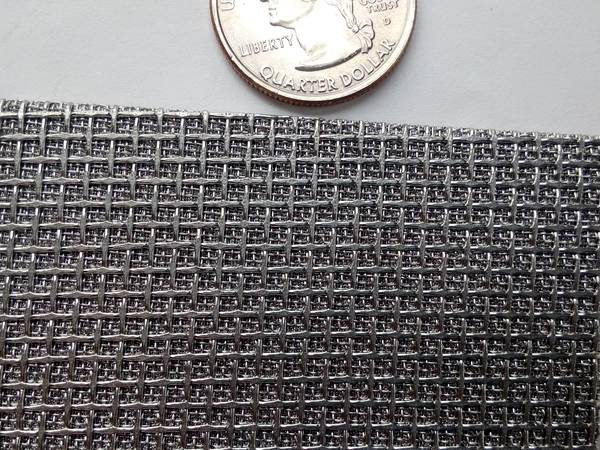 There is one piece of custom designed sintered mesh laminate, and there is one coin beside it.